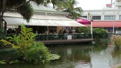 Pan of restaurant, coconut square and local people, noumea, new caledonia Stock Footage