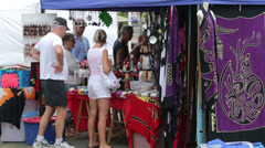 Tourists shopping for souvenirs in city market, noumea, new caledonia Stock Footage