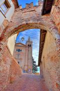 Church and ancient passage. monticello d'alba, italy. Stock Photos