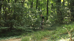 Man riding Mountain bike downhill - tracking shot Stock Footage