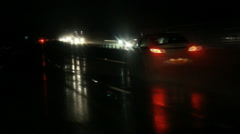Night traffic on wet road Stock Footage