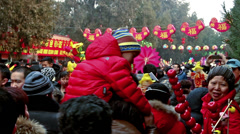 Lots of visitors holding toys at Ditan temple fair during Spring Festival Stock Footage