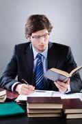 Lawyer working in his office Stock Photos