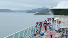 Tourists on deck as cruise ship leaves noumea, new caledonia Stock Footage