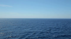 Ocean blue sky and tranquil water at sea with horizon Stock Footage