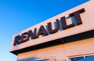 Stock Photo of the emblem renault on the office of official dealer.