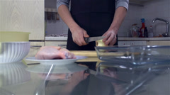 Cutting Useless Part of Onion in Kitchen - stock footage