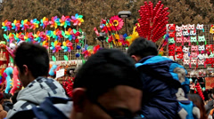 Different toy stands and the visitors at Ditan temple fair Stock Footage