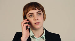 Bad news phone call for young business woman Stock Footage