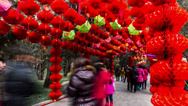 Stock Video Footage of People walk under the red lanterns at Ditan temple fair
