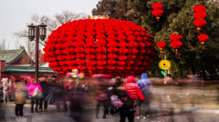 The huge lantern model and the crowded visitors at Ditan temple fair - stock footage