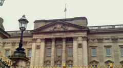 Buckingham Palace close up facade with Union Flag. Editorial Use Only Stock Footage