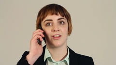 Young business woman gets shocking funny news on phone - stock footage