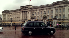 Buckingham Palace and London Taxis. Editorial Use Only Stock Footage