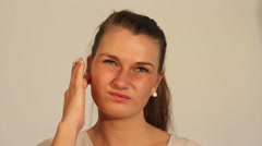 Young woman with blocked ear. Stock Footage