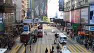 Stock Video Footage of Asia China Hong Kong downtown rushhour zebra cross commuters street scene