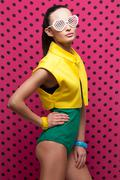 stylish model posing in colorful wear and accessories. shutter shade sunglass - stock photo