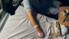 Anaesthetic in patient's hand in hospital (wide shot) Stock Footage