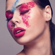 beauty shot of fashionable women face with pink, red and blue dry colours. re - stock photo