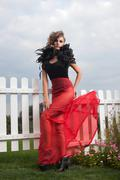 Full length portrait of fashionable model in exclusive costume Stock Photos