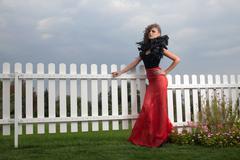 full growth portrait of fashionable model outdoors. red skirt.  black body. v - stock photo