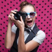 Expressive portrait of female photographer Stock Photos