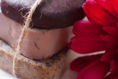 closeup of three of natural handmade soap. chocolate, orange and scrub soaps - stock photo