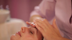 Professional massage therapist doing massage of female face at beauty spa Stock Footage
