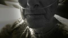 Oxygen tube on elderly patient (B&W) Stock Footage