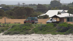 Zoom out from camper van near the beach Stock Footage