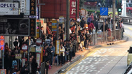 Stock Video Footage of Asia China Hong Kong downtown rushhour commuters wait for bus