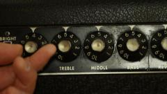 Turning amp knob to zero on vintage guitar amplifier Stock Footage