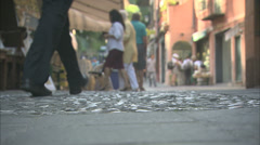 Walking along an Italian cobbled street - stock footage