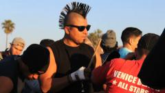 Man With Mohawk Playing Cowbell At Party Stock Footage