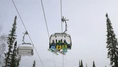 Gondola in Sheregesh ski resort lift people and they greet videographer Stock Footage