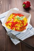 pasta with saffron and capsicum - stock photo