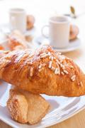 Coffee and brioches for energetic breakfast Stock Photos