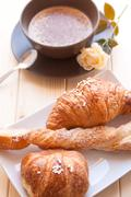 Cappuccino and brioches Stock Photos