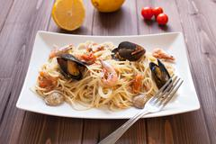 Spaghetti with clams, crayfish and shrimp Stock Photos