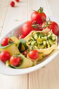 basket of parmesan with veggies - stock photo