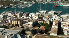 Europe Spain Balearic Ibiza Eivissa city 145 pan over harbor district Stock Footage