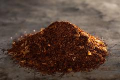 rooibos tea on a metal texture - stock photo