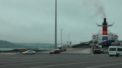 Cars and Vans unload from Ferry in port - stock footage