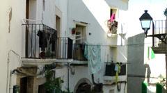 Europe Spain Balearic Ibiza Eivissa city 159 laundry on balcony railings Stock Footage