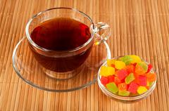 Cup of tea with candied fruits Stock Photos