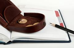 purse with one dollar coin - stock photo