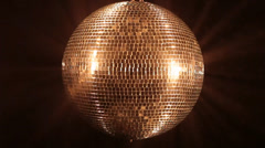 Mirror ball reflect golden light Stock Footage