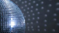 Half of disco mirror ball reflect blue-white light Stock Footage