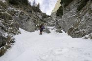 Stock Photo of rocky trail in mountains landscape in winter