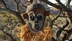 African Primitive Mask Scary Savage Landscape Tilt Up Stock Footage